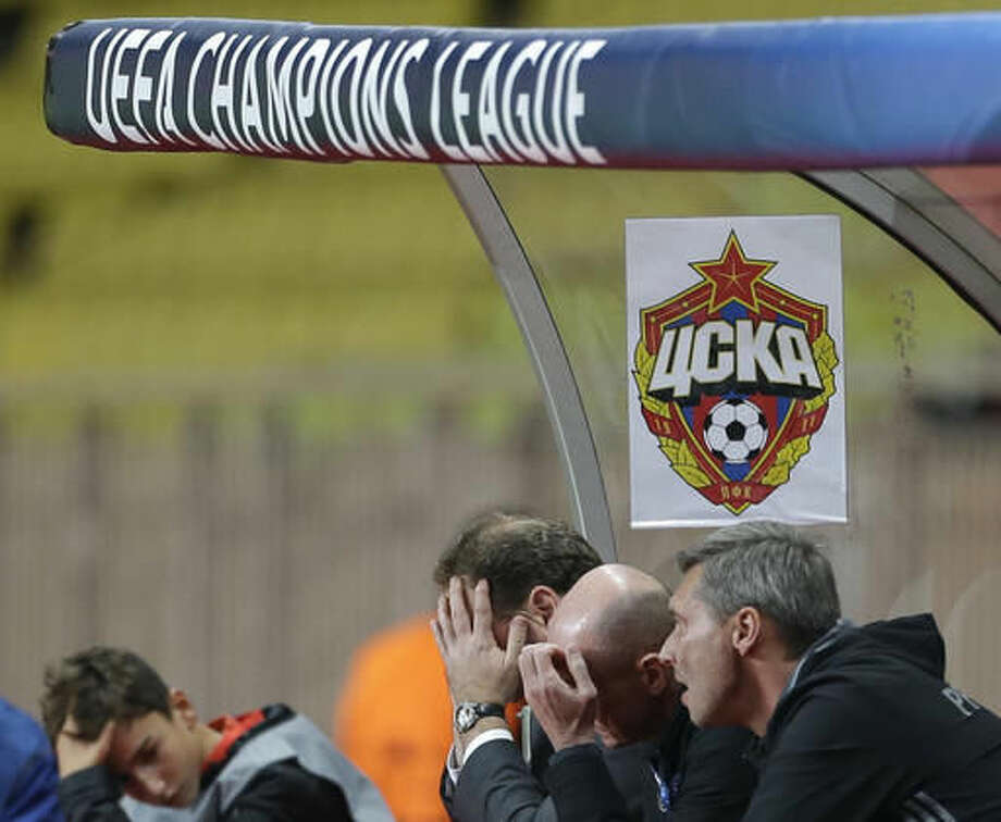 CSKA's head coach Leonid Slutski, second left, and other CSKA staff members hold their head during their Champions League Group E soccer match between Monaco and CSKA at the Louis II stadium in Monaco, Wednesday Nov. 2, 2016. (AP Photo/Claude Paris)