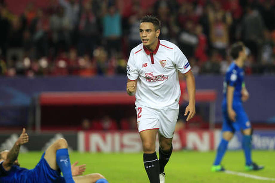 Sevilla's Wissam Ben Yedder celebrates after scoring his side's 4th goal during a Group H Champions League soccer match between Sevilla and Dinamo Zagreb at the Ramon Sanchez-Pizjuan stadium in Seville, Spain Wednesday Nov. 2, 2016. (AP Photo/Miguel Angel Morenatti)