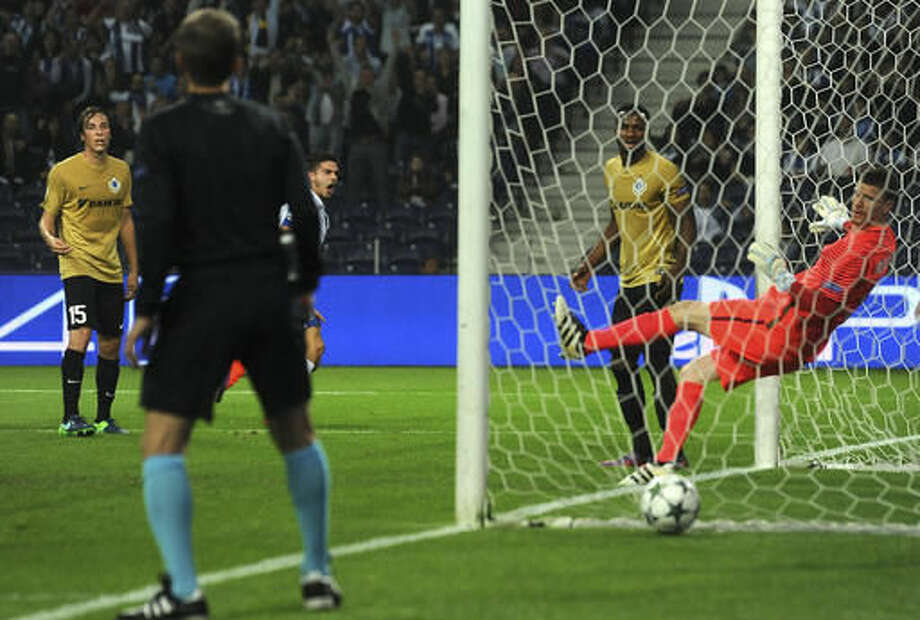 Porto's Andre Silva, 3rd left, celebrates after scoring the opening goal past Brugge's goalkeeper Ludovic Butelle, right, during a Champions League group G soccer match between FC Porto and Club Brugge at the Dragao stadium in Porto, Portugal, Wednesday, Nov. 2, 2016. (AP Photo/Paulo Duarte)