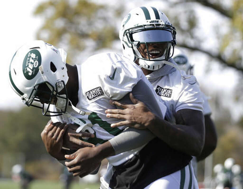 New York Jets' Brandon Marshall, right, grabs Quincy Enunwa between stretching exercises during NFL football practice, Wednesday, Nov. 2, 2016, in Florham Park, N.J. (AP Photo/Julio Cortez)