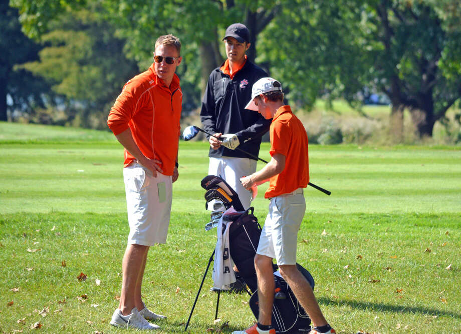 Edwardsville coach Adam Tyler, left, talks to senior Spencer Patterson, center, and junior Tanner White during Monday's Class 3A Pekin Sectional at Lick Creek Golf Course.