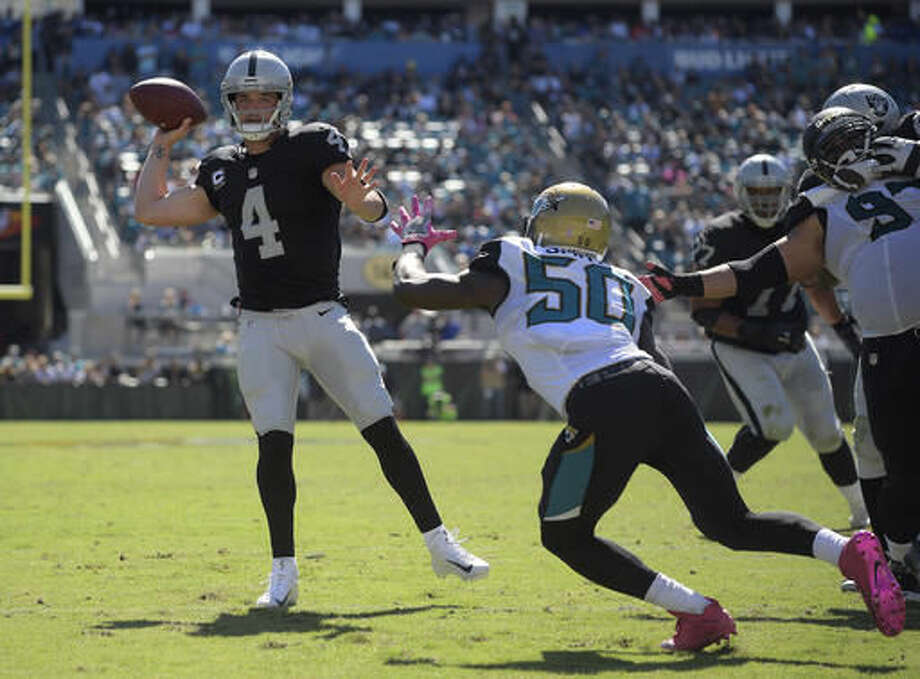 FILE - In this Oct. 23, 2016, file photo, Oakland Raiders quarterback Derek Carr (4) throws a pass against the Jacksonville Jaguars during the second quarter of an NFL football game, in Jacksonville, Fla. Carr has shown the ability to outplay his fellow young quarterbacks. The next test for the third-year passer is thriving against a top defense like Denver's. (AP Photo/Phelan Ebenhack, File)