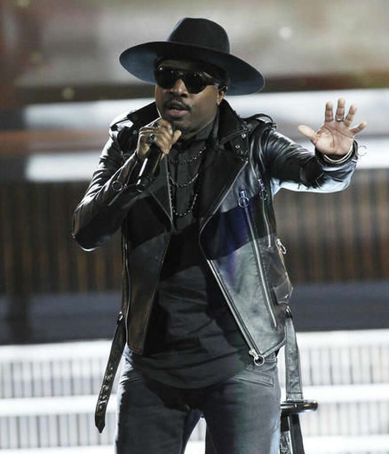 "FILE - In this July 1, 2016 file photo, singer Anthony Hamilton performs at the 13th Annual McDonald's 365 Black Awards in New Orleans. Hamilton has sung the national anthem in the past and does not plan to sing it in the future, ""We need a new song, one that really speaks for all of us, or bring some new life to the one that we have."" (Photo by Donald Traill/Invision/AP, File)"