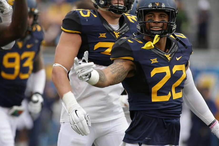 FILE - In this Nov. 28, 2015, file photo, West Virginia safety Jarrod Harper (22) gestures during an NCAA college football game in Morgantown, W.Va. West Virginia will find out whether a defense that began the season with eight new starters is ready for the nation's passing leader when they travel to Texas Tech on Saturday to face Patrick Mahomes. (AP Photo/Raymond Thompson, File)