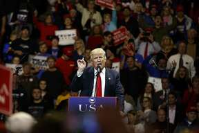 "President-elect Donald Trump gestures as he speaks during a ""USA Thank You"" tour event, Thursday, Dec. 1, 2016, in Cincinnati. (AP Photo/Evan Vucci)"