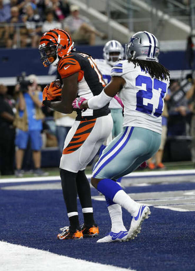 FILE - In this Sunday, Oct. 9, 2016, file photo, Cincinnati Bengals wide receiver Brandon LaFell (11) catches a pass in the end zone for a touchdown in front of Dallas Cowboys free safety J.J. Wilcox (27) in the second half of an NFL football game in Arlington, Texas. LaFell finally made his mark on the Bengals' offense by catching a pair of touchdown passes in a loss at Dallas. He's playing a bigger role as Cincinnati heads to play his former team in New England. (AP Photo/Michael Ainsworth, File)