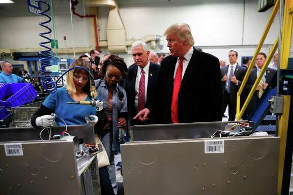 President-elect Donald Trump and Vice President-elect Mike Pence speak with workers while touring the Carrier plant Thursday in Indianapolis.