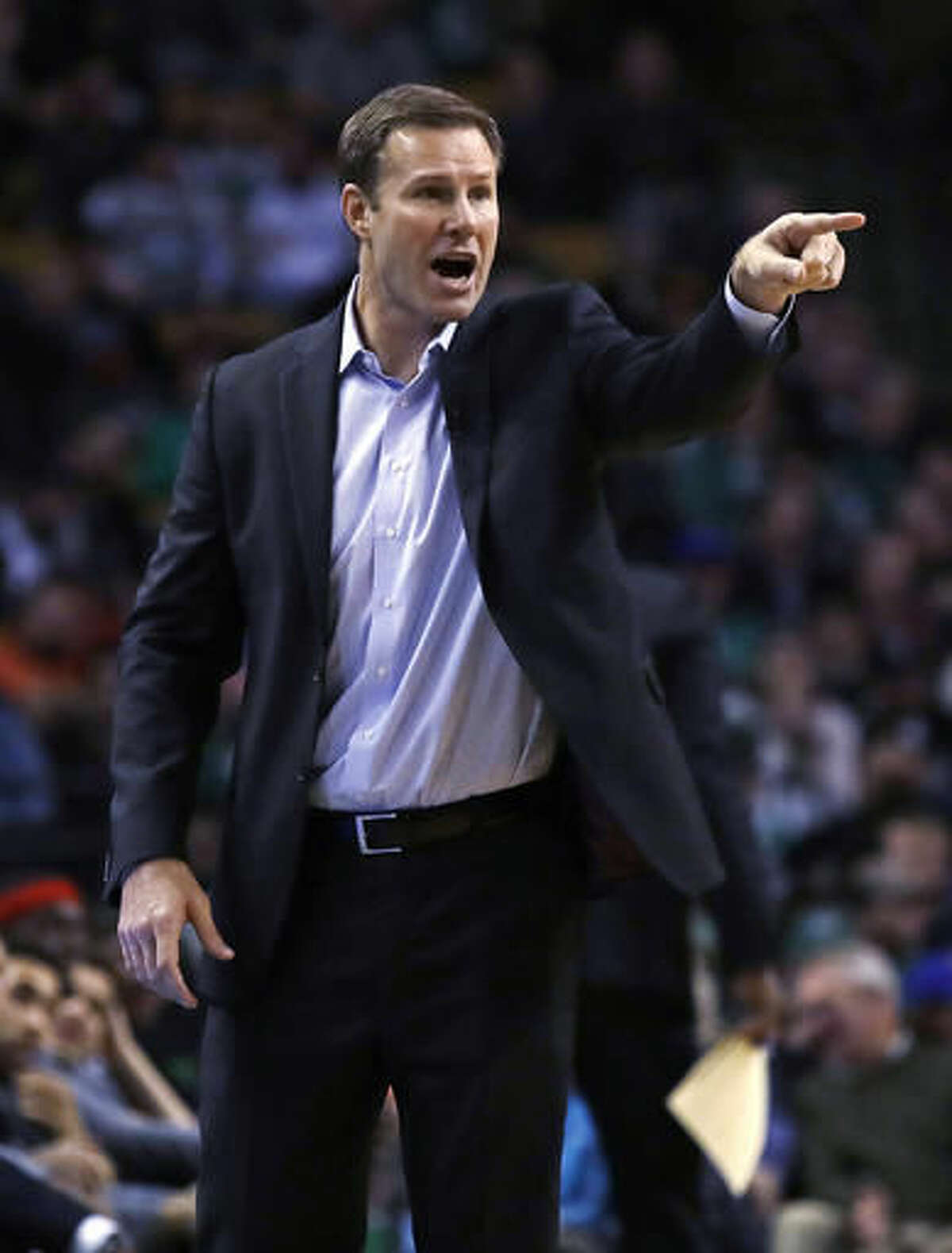Chicago Bulls coach Fred Hoiberg calls to his players during the first quarter of an NBA basketball game against the Boston Celtics in Boston, Wednesday, Nov. 2, 2016. (AP Photo/Charles Krupa)