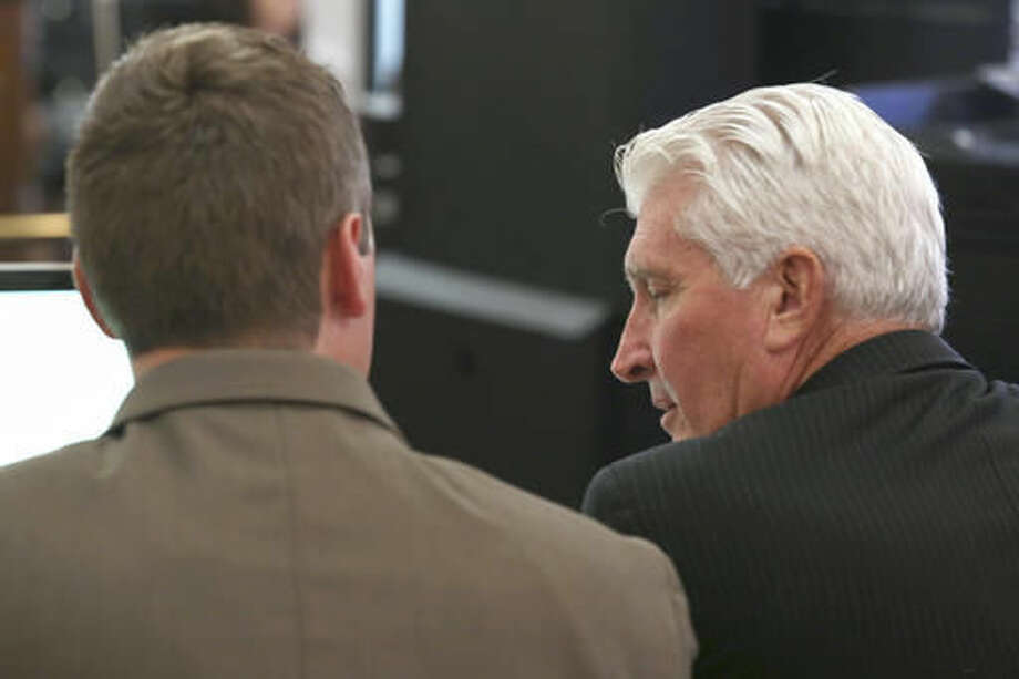 Ray Tensing, former University of Cincinnati police officer, left, talks with his lawyer, Stewart Mathews, right, during court proceedings in the courtroom of Common Pleas Judge Megan Shanahan at the Hamilton County Courthouse, Wednesday, Nov. 2, 2016, in Cincinnati. Tensing is charged with murder of Sam DuBose while on duty during a routine traffic stop on July 19, 2015. (Cara Owsley/The Cincinnati Enquirer via AP, Pool)