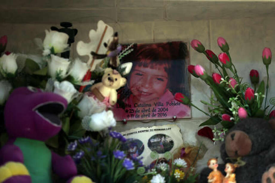"In this 22 Oct. 2016 photo, the photo of Lissette decorates her tomb in Til Til, Chile. Lissette died under the care of the Chilean state, suffocating in her own vomit while a caretaker allegedly sat on her back while trying to contain the 11-year-old during what was described as ""a crisis of aggressiveness."" (AP Photo/Luis Hidalgo)"