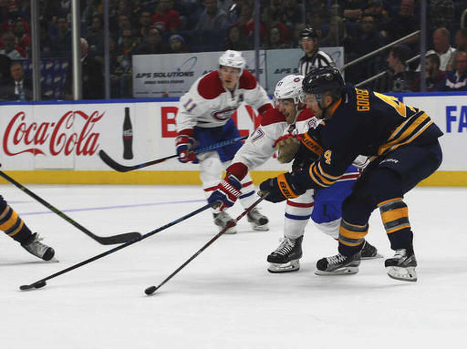 Buffalo Sabres Josh Gorges (4) and Montreal Canadiens Max Pacioretty (67) battle for the puck during the first period of an NHL hockey game, Thursday, Oct. 13, 2016, in Buffalo, N.Y. (AP Photo/Jeffrey T. Barnes)