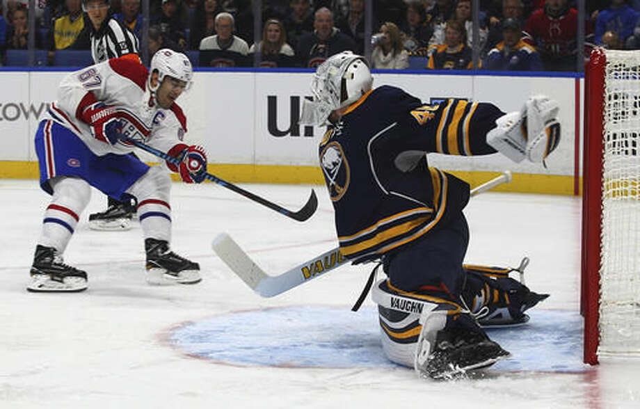 Buffalo Sabres goalie Robin Lehner (40) makes a save against Montreal Canadiens Max Pacioretty (67) during the first period of an NHL hockey game, Thursday, Oct. 13, 2016, in Buffalo, New York. (AP Photo/Jeffrey T. Barnes)
