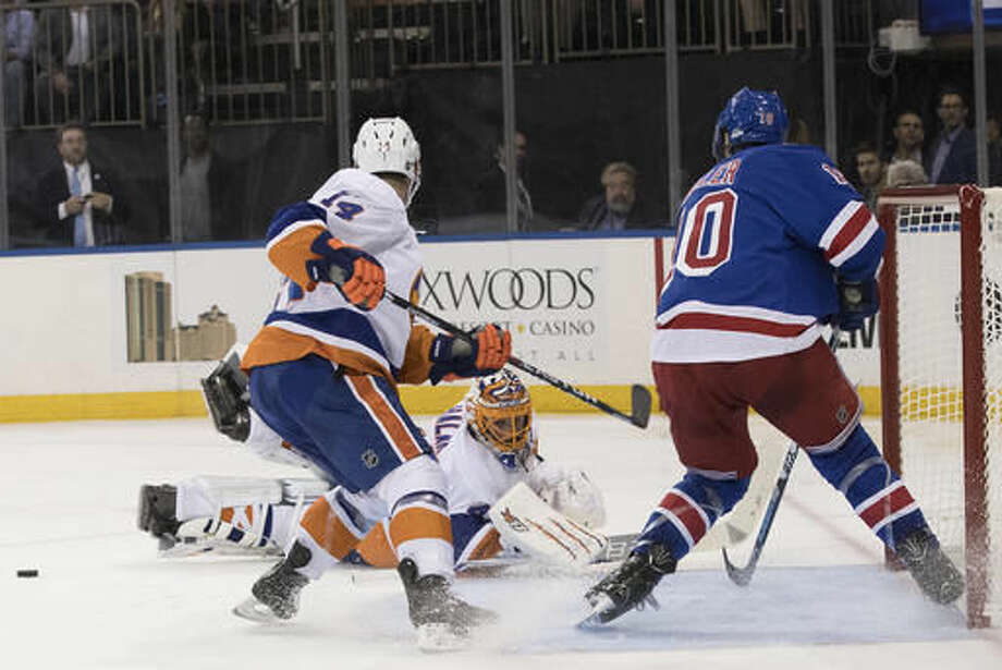 New York Islanders goalie Jaroslav Halak (41) and defenseman Thomas Hickey (14) defend the net against New York Rangers center J.T. Miller (10) during the second period of an NHL hockey game, Thursday, Oct. 13, 2016, at Madison Square Garden in New York. (AP Photo/Mary Altaffer)