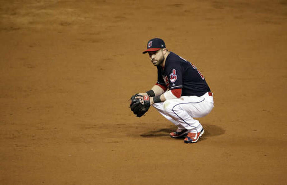 Cleveland Indians' Jason Kipnis pauses during the 10th inning of Game 7 of the Major League Baseball World Series against the Chicago Cubs Thursday, Nov. 3, 2016, in Cleveland. (AP Photo/Gene J. Puskar)
