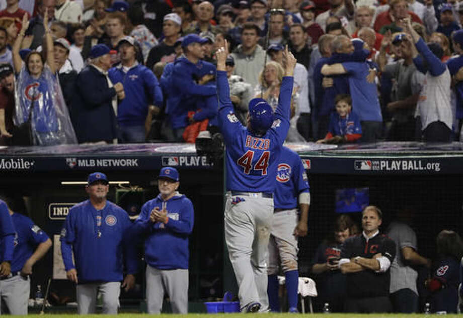 Chicago Cubs' Anthony Rizzo celebrates in the dugout after scoring on a hit by Miguel Montero during the 10th inning of Game 7 of the Major League Baseball World Series against the Cleveland Indians Thursday, Nov. 3, 2016, in Cleveland. (AP Photo/Matt Slocum)