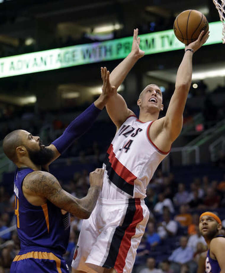 Portland Trail Blazers forward Mason Plumlee (24) shoots next to Phoenix Suns center Tyson Chandler during the first quarter of an NBA basketball game, Wednesday, Nov. 2, 2016, in Phoenix. (AP Photo/Rick Scuteri)
