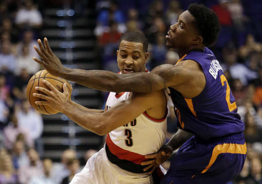 Portland Trail Blazers guard C.J. McCollum (3) gets pressured by Phoenix Suns guard Eric Bledsoe during the first quarter of an NBA basketball game, Wednesday, Nov. 2, 2016, in Phoenix. (AP Photo/Rick Scuteri)