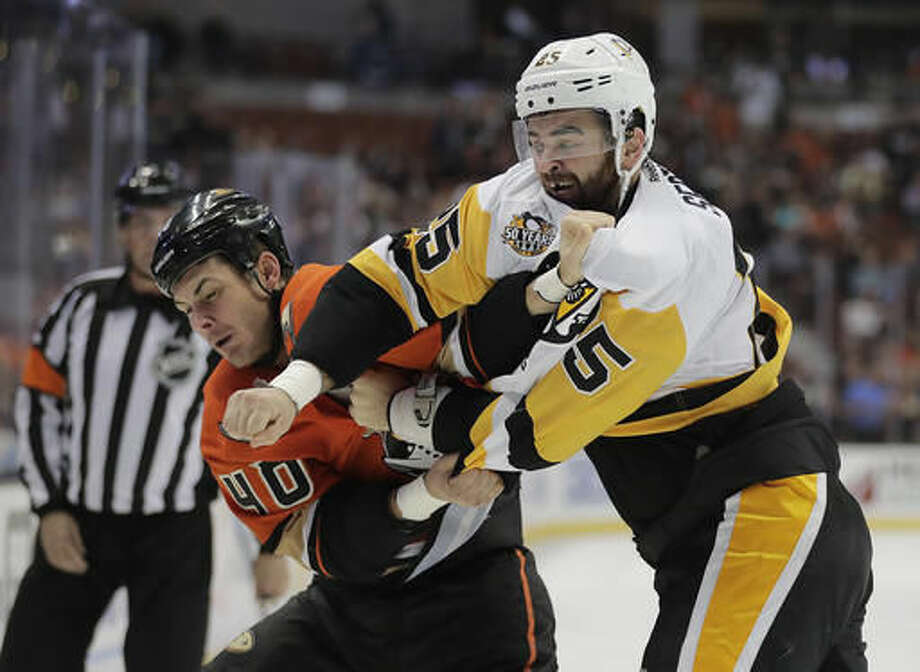 Pittsburgh Penguins' Tom Sestito, right, punches Anaheim Ducks' Jared Boll during the second period of an NHL hockey game Wednesday, Nov. 2, 2016, in Anaheim, Calif. (AP Photo/Jae C. Hong)