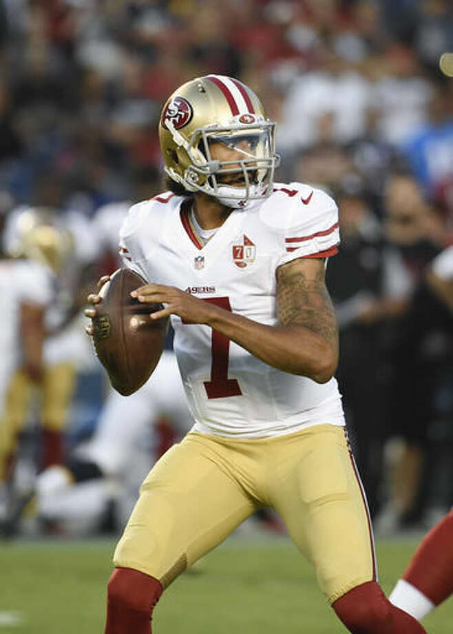 FILE - In this Sept. 1, 2016, file photo, San Francisco 49ers quarterback Colin Kaepernick (7) plays during a preseason NFL football game against the San Diego Chargers, in San Diego. (AP Photo/Denis Poroy, File)