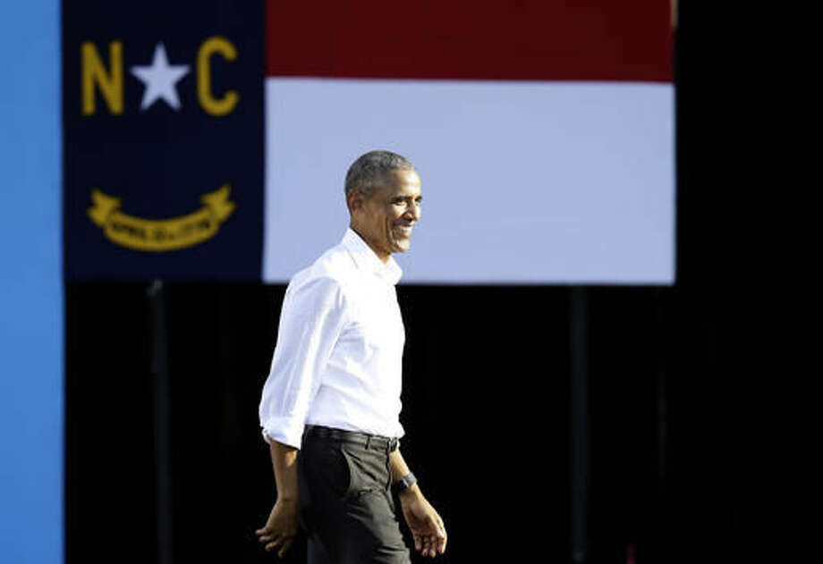 President Barack Obama leaves the stage following a speech while campaigning for Democratic presidential candidate Hillary Clinton in Chapel Hill, N.C., Wednesday, Nov. 2, 2016. (AP Photo/Gerry Broome)