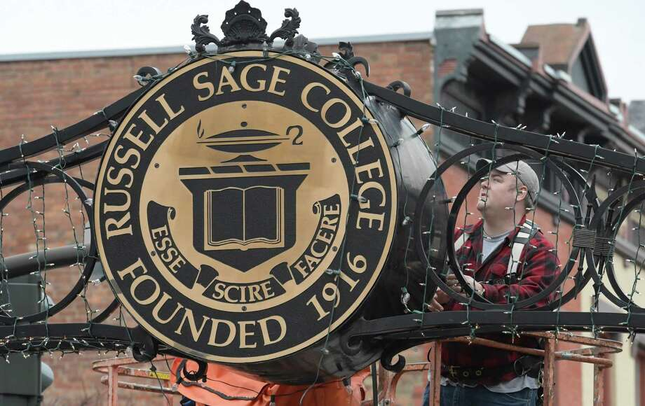 Josh Raynor of Sage Colleges staff fine tunes the Christmas lighting on the Russell Sage College sign on 1st Street Thursday Dec. 1, 2016 in Troy, N.Y.   (Skip Dickstein/Times Union) Photo: SKIP DICKSTEIN