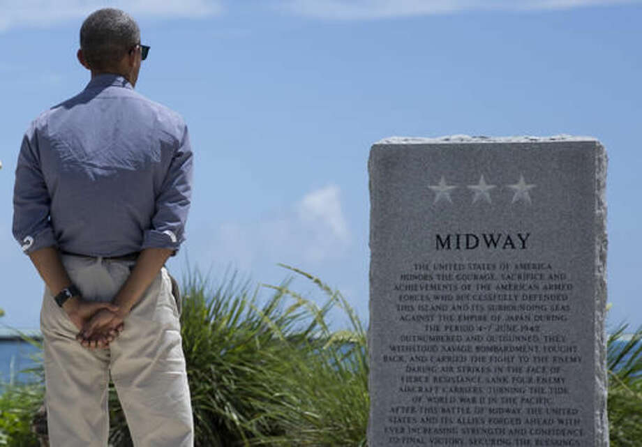 FILE — In this Sept. 1, 2016 file photo, President Barack Obama pauses at the Battle of Midway Navy Memorial as he tours Midway Atoll in the Papahanaumokuakea Marine National Monument, Northwestern Hawaiian Islands. The Battle of Midway was a major turning point in World War II's Pacific theater. The remote atoll where thousands died is now a delicate sanctuary for millions of seabirds, and a new battle is pitting preservation of its vaunted military history against the protection of its wildlife. (AP Photo/Carolyn Kaster, File)