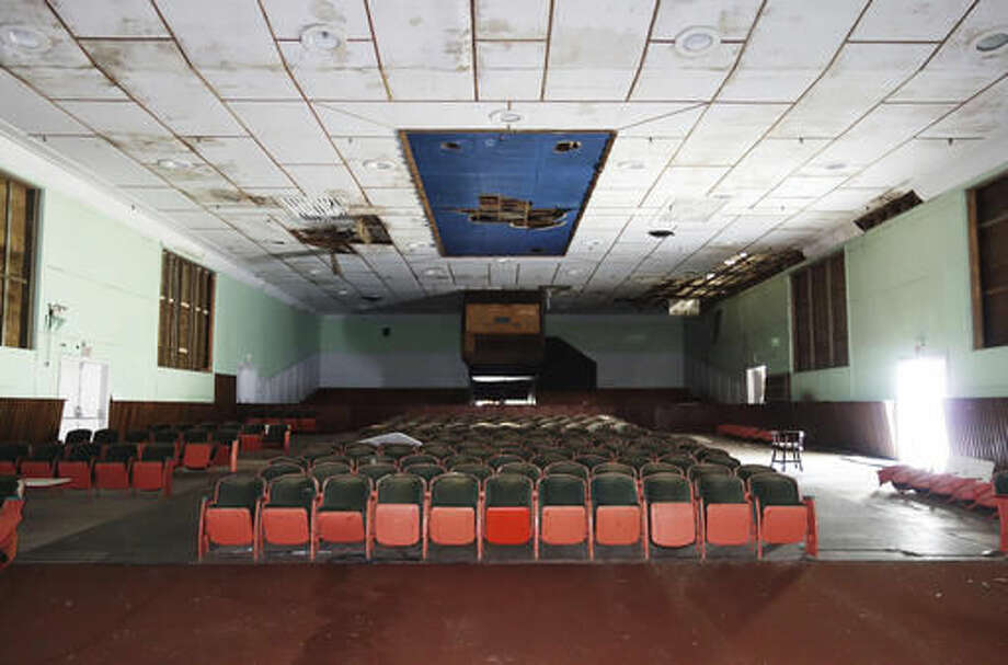 This photo April 17, 2015 photo provided by the United States Government Accountability Office shows the Theater of the Midway Mall, designed by the architect Albert Kahn, and constructed before the Battle of Midway during World War II. The theater is eligible for inclusion in the National Register of Historic Places. The Battle of Midway was a major turning point in World War II's Pacific theater. But the remote atoll where thousands died is now a delicate sanctuary for millions of seabirds, and a new battle is pitting preservation of its vaunted military history against the protection of its wildlife. Six murals were removed from the theater and sent to the Pacific Aviation Museum for preservation and display. (U.S. Government Accountability Office via AP)
