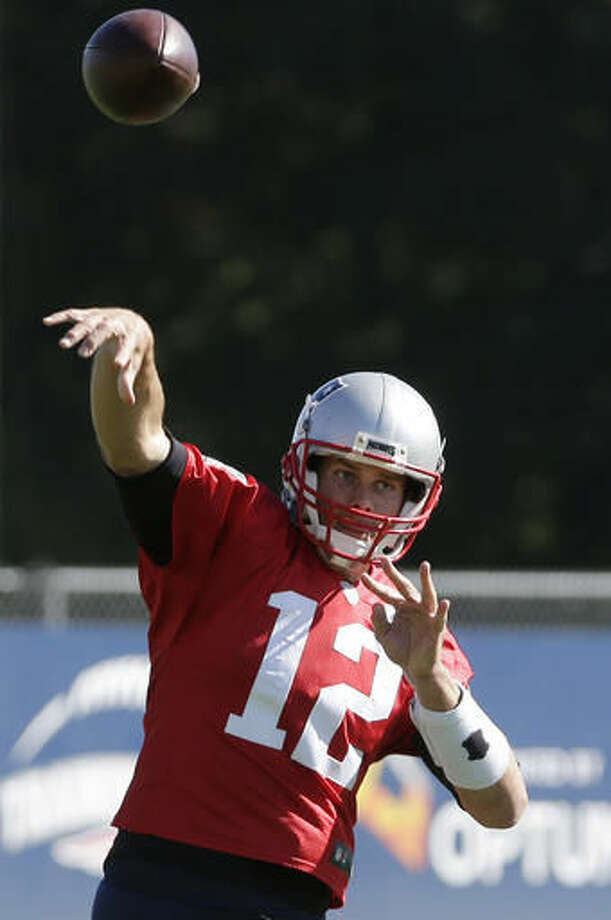 New England Patriots quarterback Tom Brady throws a pass during an NFL football practice Wednesday, Oct. 12, 2016, in Foxborough, Mass. (AP Photo/Steven Senne)