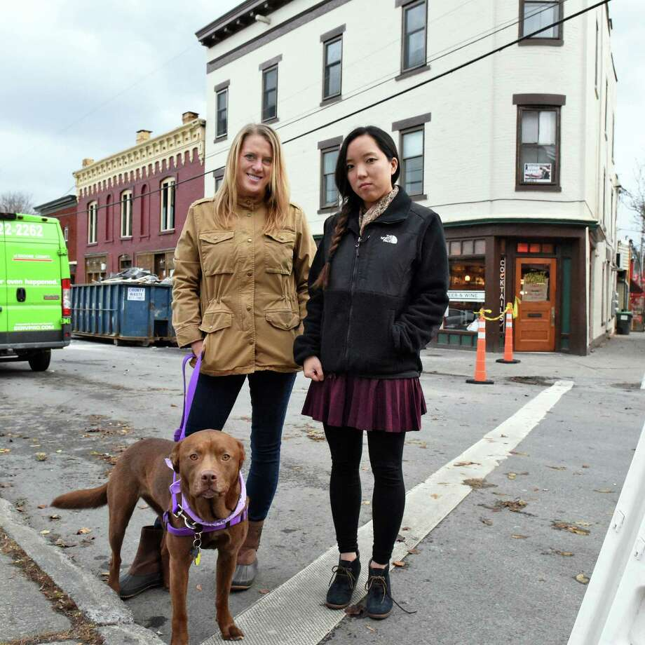 Tiffany Merritt, left, Lauren Crispino, and their dog River outside their old apartment on Caroline Street Thursday Dec. 1, 2016 in Saratoga Springs, NY. They were among those displaced by the big Thanksgiving fire.   (John Carl D'Annibale / Times Union) Photo: John Carl D'Annibale / 20039025A