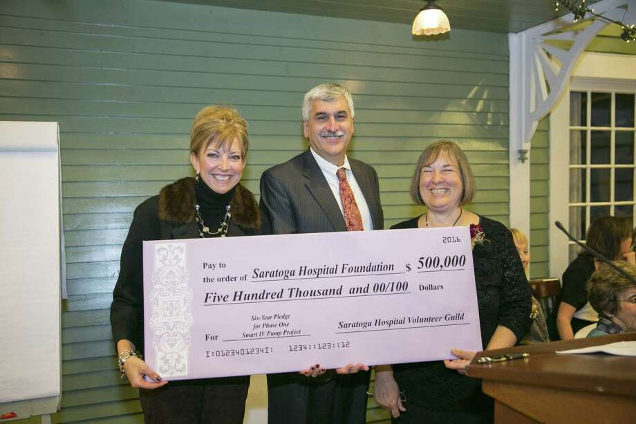"From left, Amy Raimo, Saratoga Hospital Foundation executive director and vice president for community engagement, hospital president and CEO Angelo G. Calbone and hospital Volunteer Guild President Barbara King celebrate the guild's pledge of $500,000 — the auxiliary organization's largest gift ever — to help bring ""smart"" intravenous (IV) pumps to all Saratoga Hospital facilities.  The gift also is the most significant to date for the hospital's newest fundraising initiative, which seeks more than $1 million to buy and set up 270 smart pumps and related software. IV pumps have long been used to deliver lifesaving fluids, from blood products to advanced antibiotics, insulin, and chemotherapy. Smart pumps include technology designed to ensure that patients receive the right medication at the right dose and the right time. (Submitted photos)"