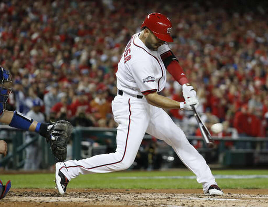 Washington Nationals' Danny Espinosa hits an RBI single during the second inning in Game 5 of baseball's National League Division Series against the Los Angeles Dodgers, at Nationals Park, Thursday, Oct. 13, 2016, in Washington. (AP Photo/Alex Brandon)