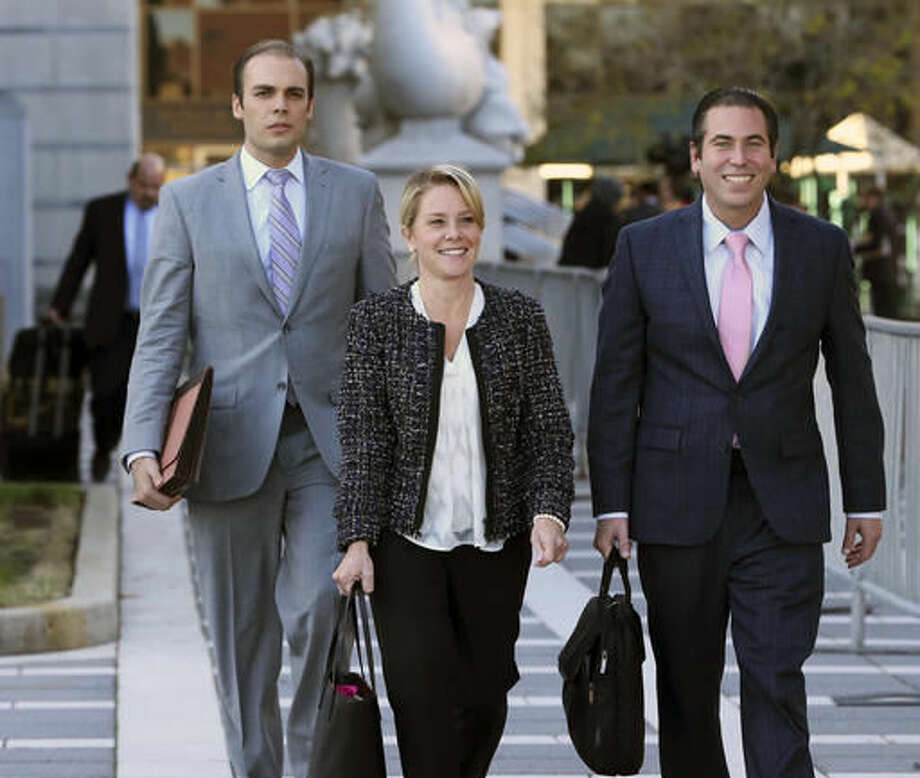 Bridget Kelly, center, New Jersey Gov. Chris Christie's former deputy chief of staff, walks from Martin Luther King Jr. Courthouse after a hearing, Monday, Oct. 31, 2016, in Newark, N.J. Closing arguments wrapped up Monday in the George Washington Bridge lane-closing case and the jury began deliberations. (AP Photo/Mel Evans)