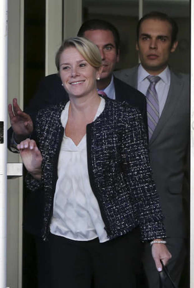 Bridget Kelly, front, New Jersey Gov. Chris Christie's former deputy chief of staff, leaves Martin Luther King Jr. Courthouse after a hearing, Monday, Oct. 31, 2016, in Newark, N.J. Closing arguments wrapped up Monday in the George Washington Bridge lane-closing case and the jury began deliberations. (AP Photo/Mel Evans)