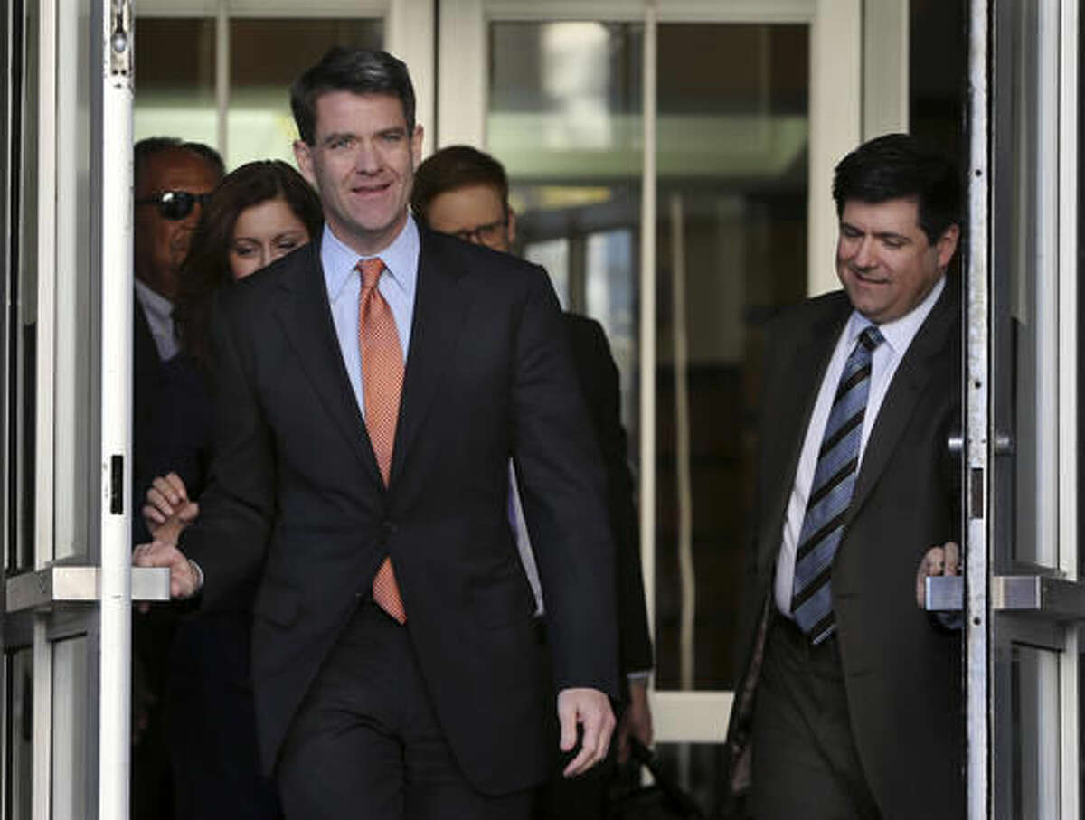 Bill Baroni, front left, New Jersey Gov. Chris Christie's former top appointee at the Port Authority of New York and New Jersey, and his attorney Michael Baldassare, right, leave Martin Luther King Jr. Courthouse after a hearing, Monday, Oct. 31, 2016, in Newark, N.J. Closing arguments wrapped up Monday in the George Washington Bridge lane-closing case and the jury began deliberations. (AP Photo/Mel Evans)