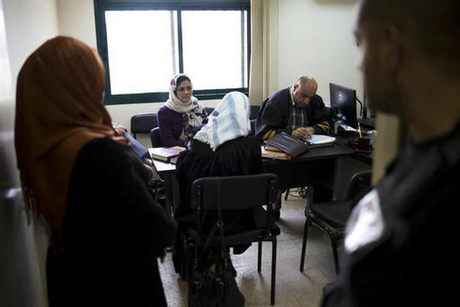 ADVANCE FOR TUESDAY, NOV. 1, 2016 - In this Tuesday, March 29, 2016 photo, a Palestinian woman, second from left, seeking custody of her son, listens to proceedings in her case in the Islamic family court in Ramallah, West Bank. Across the Arab world, women have gained ground in education and health, but inequality is still entrenched in most family courts. (AP Photo/Dusan Vranic)
