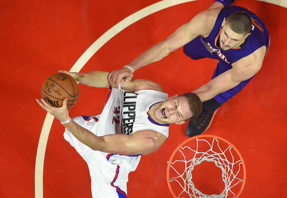 Los Angeles Clippers forward Blake Griffin, left, is fouled by Phoenix Suns center Alex Len, of Ukraine, as he shoots during the second half of an NBA basketball game, Monday, Oct. 31, 2016, in Los Angeles. The Clippers won 116-98. (AP Photo/Mark J. Terrill)