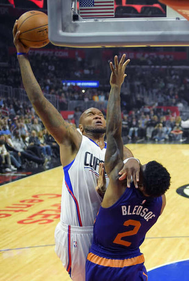 Los Angeles Clippers center Marreese Speights, left, shoots as Phoenix Suns guard Eric Bledsoe defends during the first half of an NBA basketball game, Monday, Oct. 31, 2016, in Los Angeles. (AP Photo/Mark J. Terrill)