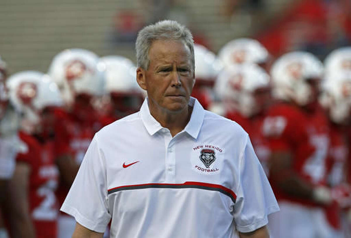 FILE - In this Sept. 1, 2016, file photo, New Mexico coach Bob Davie watches players warm up for the team's NCAA college football game against South Dakota in Albuquerque, N.M. New Mexico faces Air Force on Saturday in Dallas. (AP Photo/Andres Leighton, File)