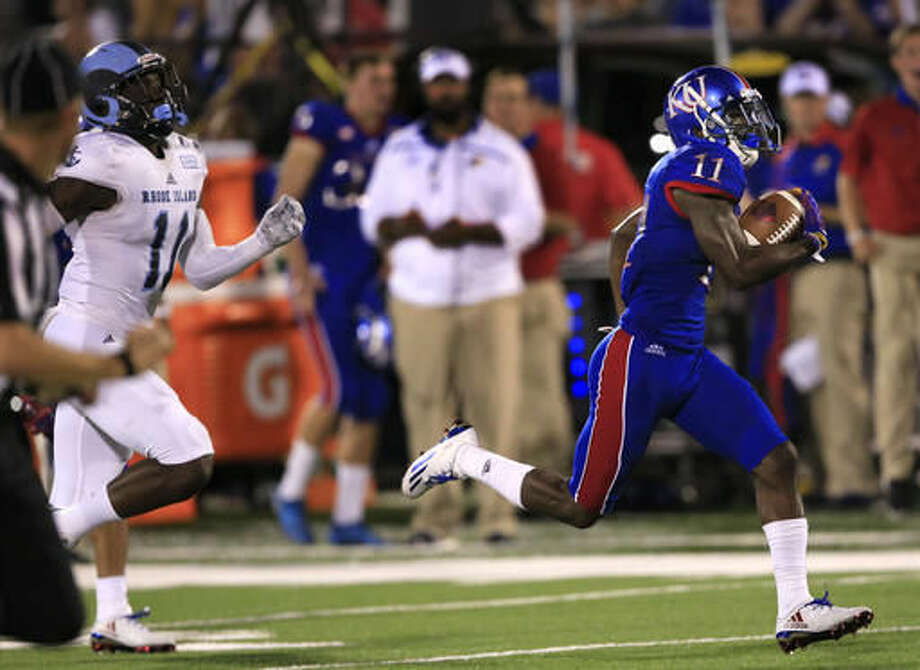 FILE - In this Sept. 3, 2016, file photo, Kansas wide receiver Steven Sims Jr. (11) runs for a touchdown past Rhode Island defensive back D.J. Stewart (11) during the second half of an NCAA college football game in Lawrence, Kan. Kansas is still trying to get out of the Big 12 cellar while serving as Homecoming opponents their next two road games. (AP Photo/Orlin Wagner, File)