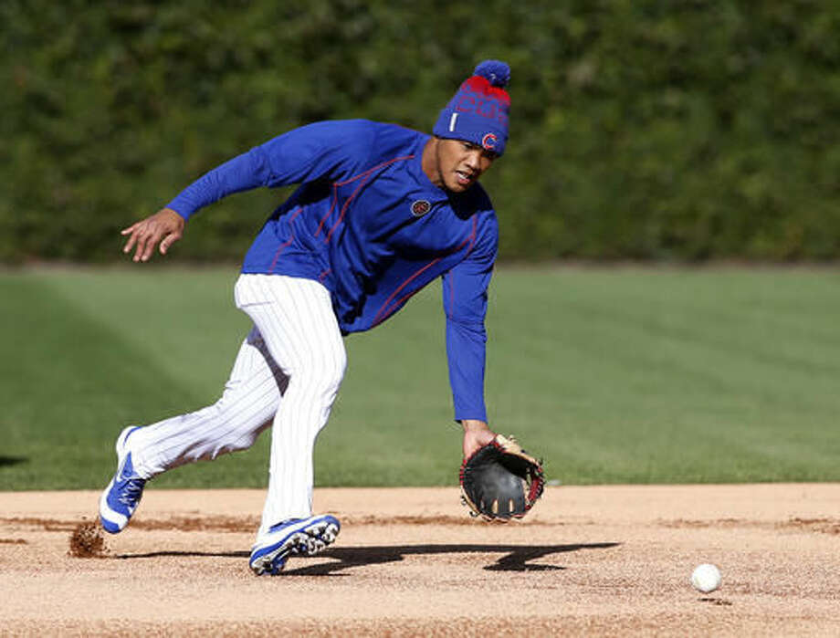 Chicago Cubs' Addison Russell takes fielding practice during a team workout in preparation for Saturday's Game 1 in baseball's National League Championship Series in Chicago, Thursday, Oct. 13, 2016. (AP Photo/Nam Y. Huh)