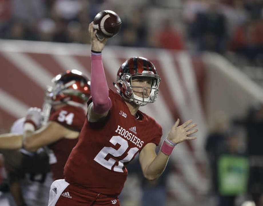 FILE - In this Oct. 1, 2016, file photo, Indiana quarterback Richard Lagow (21) throws during the team's NCAA college football game against Michigan State in Bloomington, Ind. Nebraska senior Tommy Armstrong Jr. and Indiana junior Richard Lagow could put on quite an air show Saturday. They're ranked second and third in the Big Ten in passing efficiency with nearly identical numbers. (AP Photo/Darron Cummings, File)