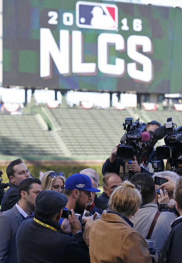 Chicago Cubs' Ben Zobrist talks to the media during a team workout in preparation for Saturday's Game 1 in baseball's National League Championship Series in Chicago, Thursday, Oct. 13, 2016. (AP Photo/Nam Y. Huh)