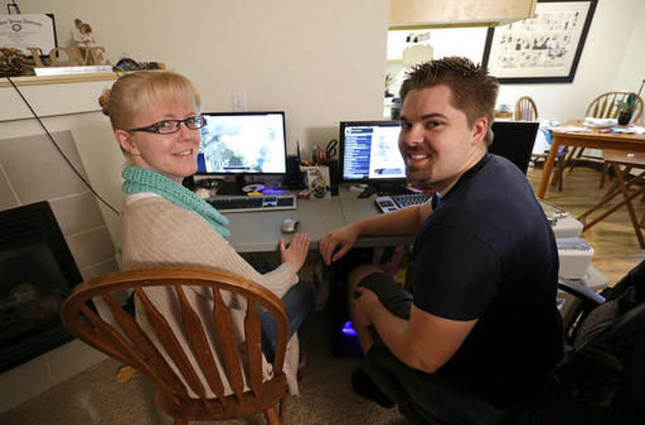 "In this Thursday, Oct. 13, 2016, photo, Shavonne Henry, left, poses with her husband, Michael Henry, while playing the computer game ""Civilization,"" at their apartment in Vancouver, Wash. Nearly half of all Americans aged 18 to 30 have nothing in retirement savings and no access to a traditional pension, according to a survey. ""I feel pretty good about our future,"" says Shavonne Henry. ""The reason we got to saving at all was I took a finance class in college, and part of the course was: If you want to have the kind of retirement you want to have, you should start saving at 20,"" she says. ""I don't think that's talked about enough."" (AP Photo/Don Ryan)"
