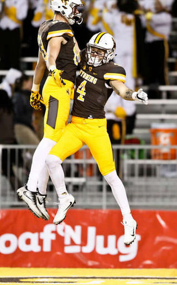 Wyoming wide receiver Tanner Gentry (4) celebrates with wide receiver Jake Maulhardt (83) after scoring a touchdown during the first half of an NCAA college football game in Laramie, Wyo., Saturday, Nov. 5, 2016. (AP Photo/Shannon Broderick)