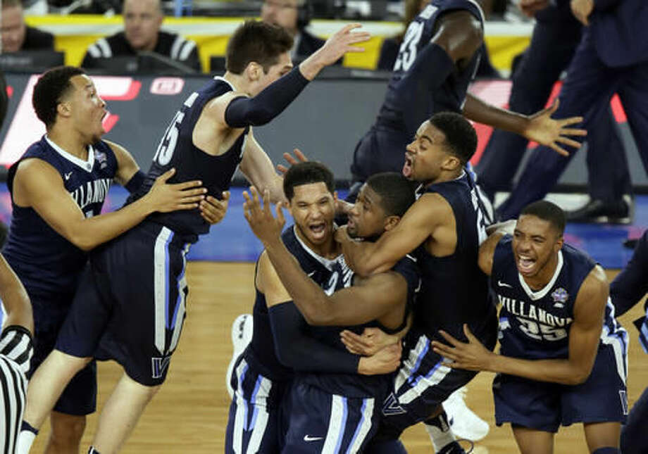 ADVANCE FOR WEEKEND EDITIONS, NOV. 5-6 - FILE - In this April 4, 2016, file photo, Villanova players celebrates after Kris Jenkins, center, made the game-winning basket as they defeated North Carolina 77-74 in the championship game of the the NCAA Final Four college tournament in Houston. The Wildcats reign as champions for the first time in three decades. (AP Photo/Charlie Neibergall, File)