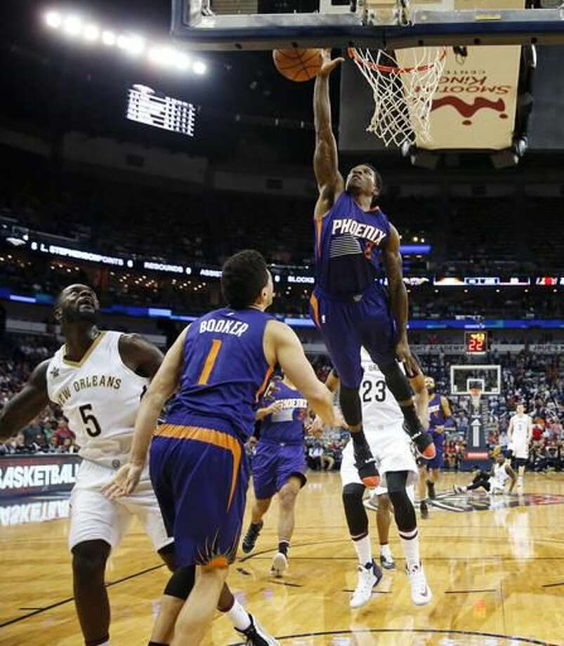 Phoenix Suns guard Eric Bledsoe (2) tries to block a shot by New Orleans Pelicans guard Lance Stephenson (5) during the second half of an NBA basketball game in New Orleans, Friday, Nov. 4, 2016. The Suns won 112-111 in overtime. (AP Photo/Gerald Herbert)