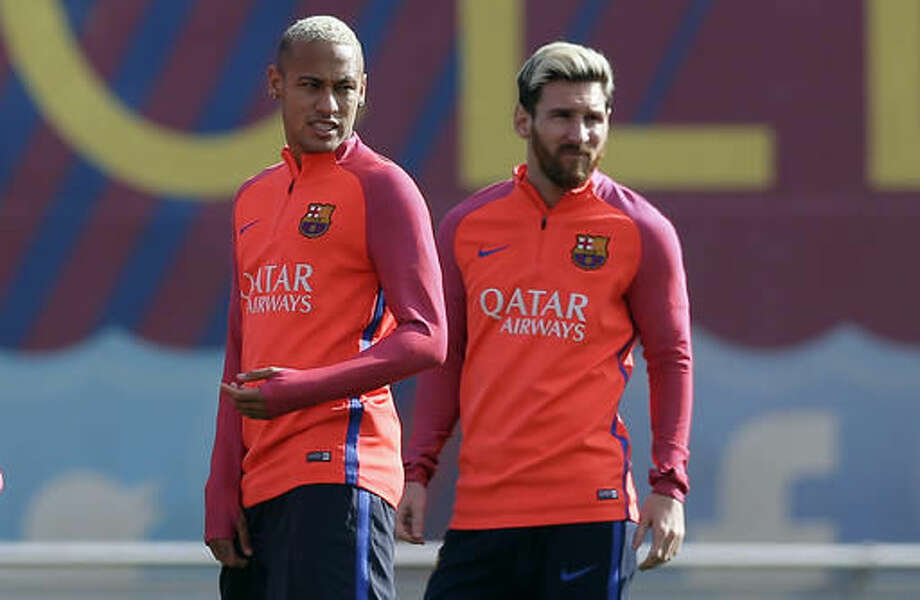 FC Barcelona's Lionel Messi, right, and Neymar attend a training session at the Sports Center FC Barcelona Joan Gamper in Sant Joan Despi, Spain, Friday, Oct. 14, 2016. (AP Photo/Manu Fernandez)