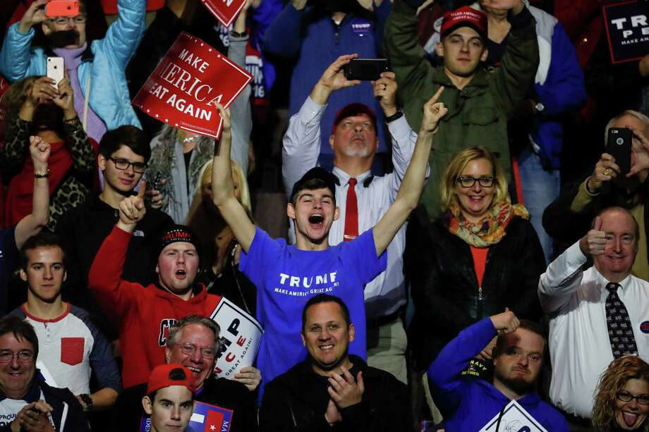 Supporters cheer as President-elect Donald Trump speaks during the first stop of his post-election tour on Thursday in Cincinnati. Photo: John Minchillo, STF / AP
