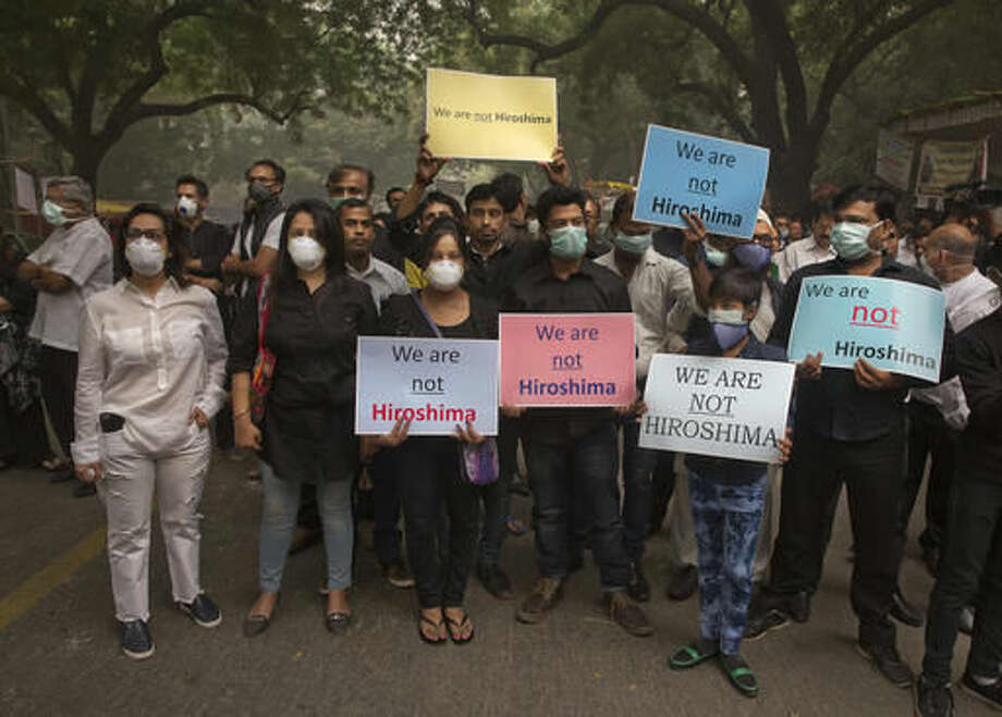 Indians wear pollution masks and hold posters and banners during a protest against air pollution in New Delhi, India, Sunday, Nov. 6, 2016. Even for a city considered one of the worlds dirtiest, the Indian capital hit a new low this week. Air so dirty you can taste and smell it; a gray haze that makes a gentle stroll a serious health hazard. According to one advocacy group, government data shows that the smog that enveloped the city midweek was the worst in the last 17 years. (AP Photo/Manish Swarup)