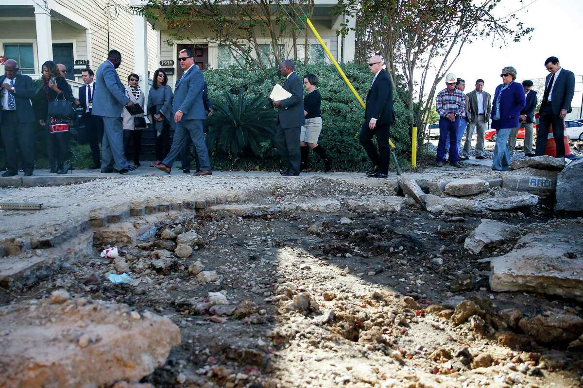 In Freedmen's Town this month, Mayor Sylvester Turner, center, assured residents that a city archaeologist will be on-site when the historic bricks are returned to their original place along Andrews Street.
